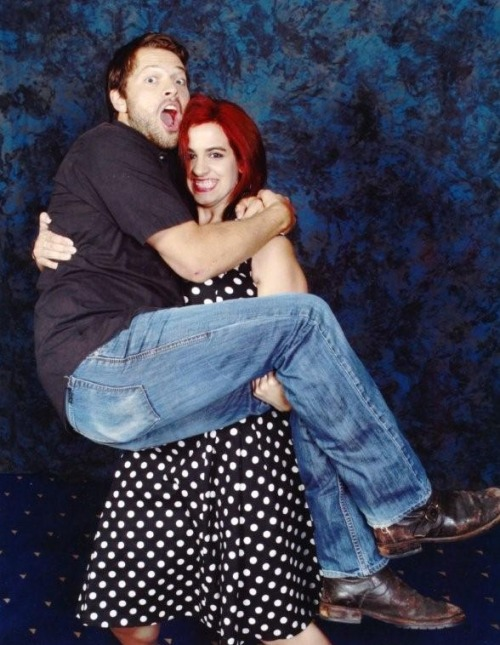 "euclase:  staceejaxxed:  that time my sister dropped Misha Collins So, as my sister Kerry told it to me, she was waiting in line for her photo op and a lot of the girls in front of her we making Misha pick them up for their photo. Naturally, my sister said, well why don't I pick you up? Except, you know, not for real, just one leg, not actually picking up Misha, he's heavy. So she picked up one leg, all was going fine, then just before the camera went off, Misha jumped into my sister's arms. Kerry was able to hold him up for about 2 point 5 seconds, then they collapsed on the floor.  Misha must have told Jensen and Jared later, because as she was going in for an autograph, Cliff mentioned it and Jensen went ""That was YOU?"" So yes. My sister almost broke Misha Collins' back.   Oh my Christ this is the funniest thing ever."