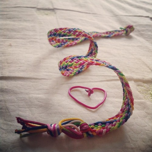 The handmade bracelet that I did last summer and the the paper clip that I twisted into a heart-shape. (Taken with Instagram)