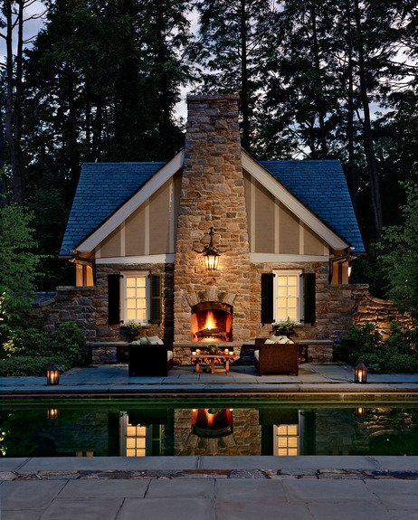 such a lovely rustic mansion with an outer fireplace!