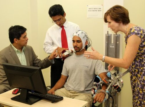 "Government-Backed Research Developing Brain-Controlled Robotic Exoskeleton  Patients who have suffered a stroke or other injury can lose the active use of their limbs, rendering them unable to simply think about moving an arm or hand and then do it. Sometimes it's possible to re-establish the lost connection, with time and repetitive physical therapy. Researchers at Rice University are using a robotic exoskeleton and a neural interface to improve matters. Unlike other neural interfaces implanted in the brain, this system uses an electroencephalograph (EEG), which monitors waves of activity in the brain. It will work by first recording the brain activity of healthy patients, and turning those signals into a control output that an exoskeleton can understand. Then the system will be further trained with stroke patients who have some ability to initiate movements. The goal is to develop control patterns that can work on any patient, even those with no ability to initiate willful movements — the robot will interpret any person's brain activity and translate it into the right motion, performing the movements over and over again to retrain the patient's motor pathways. ""With a lot of robotics, if you want to engage the patient, the robot has to know what the patient is doing,"" said principal investigator Marcia O'Malley, an associate professor of mechanical engineering and materials science at Rice. ""If the patient tries to move, the robot has to anticipate that and help. But without sophisticated sensing, the patient has to physically move – or initiate some movement."" The project has already successfully reconstructed three-dimensional hand and walking movements from brain signals, according to a Rice news release. Now a $1.17 million grant from the National Institutes of Health and the president's National Robotics Initiative will test it on 40 patients over the next two years.  (via Federal Robotics Initiative Gives $1 Million to Make Brain-Controlled Exoskeletons 