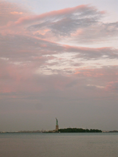 A rare shot: sunrise over the Statue of Liberty during an early Sunday morning excursion down to Battery Park.