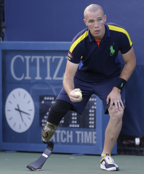 "newsweek:  Hero of the Day: Army Specialist Ryan McIntosh, 23, lost his leg after stepping on a landline in Afghanistan and this week is a bellboy at the U.S. Open. He beat out 600 others for the position. When asked if he could throw a ball, he allegedly said, 'I've thrown grenades, so I think I can handle a tennis ball.'""  Wow. ""landline"" ""bellboy"" Newsweek is in serious need of a copy editor, it seems."