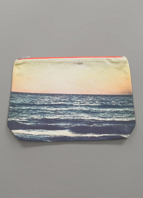 Who says summer has to end? Make this cute pouch by Dezso your go-to item and it definitely doesn't have to!