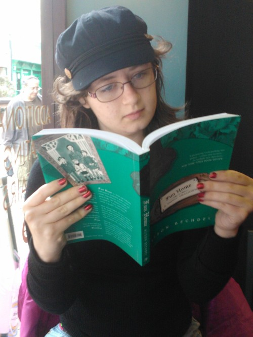 My friend Christie Reading 'Fun Home' by Alison Bechdel, in a local café.
