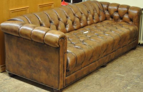 Brown leather three seater button-back Kittinger sofa                         SOLD