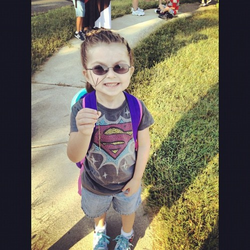 My daughter before getting on the school bus! She is loving school. Having a blast! #supergirl #geekgirl #awesome #daddysgirl (Taken with Instagram)