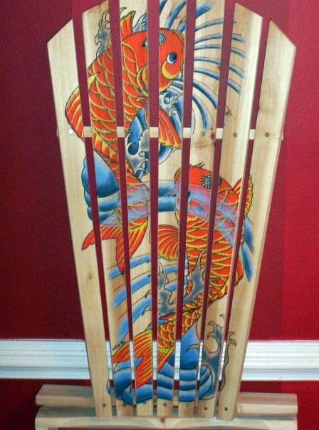 An adirondack chair that I painted a pair of koi fish on.