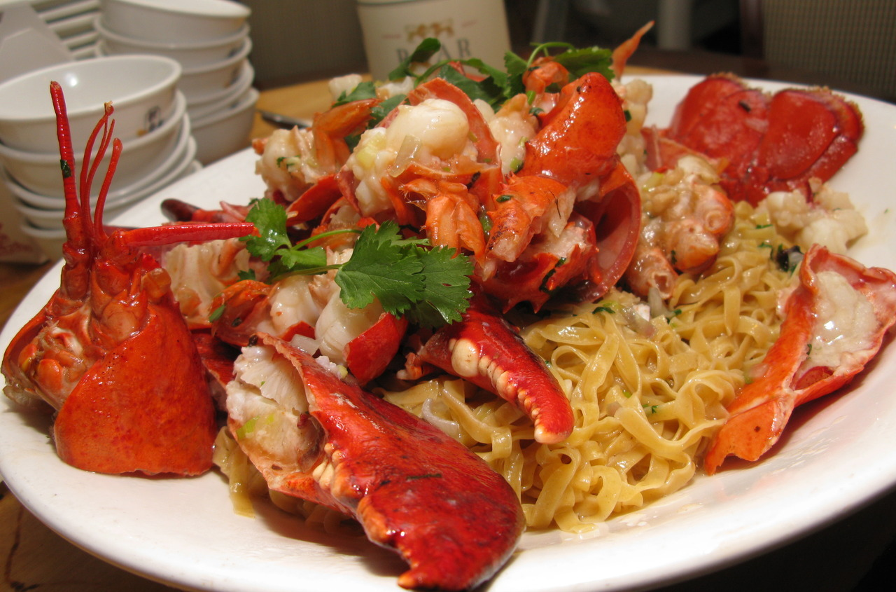 eatagoodlife:  Insanely delicious braised lobster over noodles. Awesome!