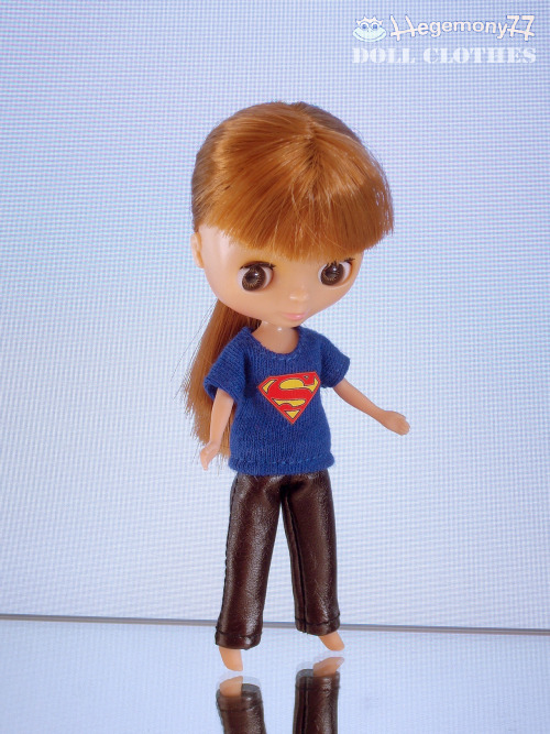 Petite Blythe in Superman T shirt and burgundy leather pants