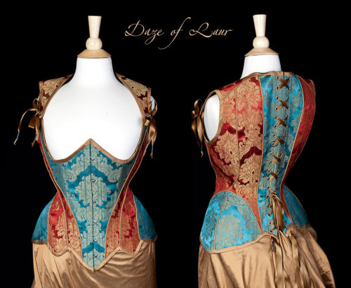 thelingerieaddict:  transientfashion:  Teal and Red Highbacked corset by ~Cuddlyparrot  Daze of Laur is amazing.