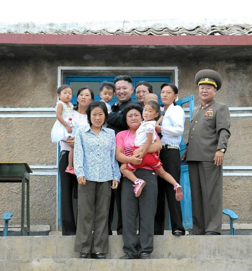 This family photograph of Kim Jong Un that Melinda introduced to me is one of my new favorite things.   Just look at how well a North Korean dictator who has allegedly had plastic surgery to look more like his grandfather gets along with his nearest and dearest.   Never mind that the rest of his family is either terrified or crying, Kim Jong Un is beaming! At best, you could argue that a couple of his relations have neutral facial expressions, but the horror on the majority of their faces makes this the most epic Awkward Family Photo ever.   It would almost be funny if weren't clear that these people had guns pointed at them and are undoubtedly living a hellacious life.