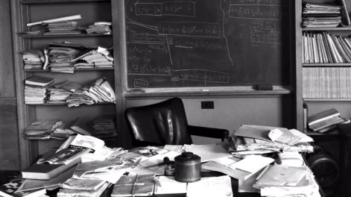 explore-blog:  Albert Einstein's desk, photographed immediately after his death and featuring his unfinished manuscripts of the Unified Field Theory, a.k.a. The Theory of Everything, which aspired to summarize all the physical forces in the universe. From The Universe in a Nutshell.