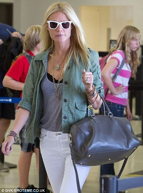 elizabethswardrobe:  Gwyneth Paltrow at LAX, carrying the first Hedi Slimane bag for Yves Saint Laurent. What do you think?