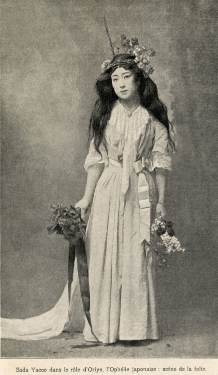 "okiya:  Sadayakko as Ophelia (1905) ""Sadayakko (貞奴) was her stage name as an actress and dancer, derived from a combination of her real name, Sada Koyama, and her geisha name, Yakko. Born in 1871, the twelfth child of a Samurai family, which had fallen into poverty, she was indentured to the Hamada okiya (geisha house) in the Yoshi-cho hanamachi (geisha district) of Tokyo at the age of four. In 1893, after a successful career as a geisha, she retired at the age of twenty-two to marry Otojiro Kawakami, a 'new wave' actor and theatrical entrepreneur. However, after only a few years of marriage they were in severe financial difficulties when one of his major ventures failed. So, in 1899 the couple leapt at an opportunity to tour the United States of America where, at the age of twenty-eight she re-invented herself as Sadayakko (or Sada Yacco), the first female actor in Japan for two hundred and fifty years. After a tumultuous beginning, Sadayakko eventually found acclaim and they went on to tour Paris and the European capitals where Sadayakko was feted as a star, her performances influencing artistic luminaries of the time such as, Pablo Picasso, Isadora Duncan and Claude Debussy. The couple returned to Japan in August 1902 and went on to champion 'new wave' theatre and European-style productions at home, re-interpreting many of the Western classics for a Japanese audience. Her portrayal of Orié (Ophelia) was a triumph, her long black tresses tumbling to her waist, her face like that of a little lost child, wearing a pale water-blue dress trimmed with white lace, flowers in her hair and in her hands, singing snatches of nursery rhymes ""rain is falling on his grave…no, not rain, it is tears of blood""."" (source)"