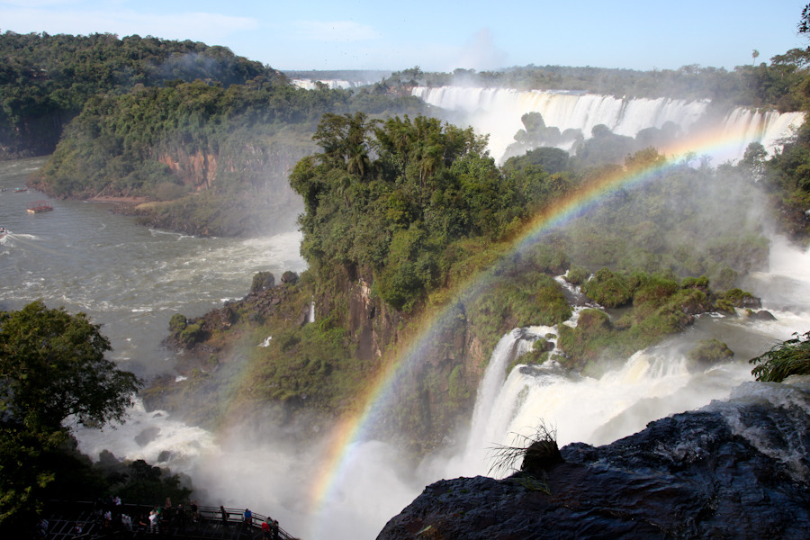 Iguazu Falls One of the great natural wonders of the world, these falls are incredíble!! Massive and set against the backdrop of a steamy subtropical rainforest, las cataratas (waterfalls) should definitely be on anyone's bucket list. It's a magical place, with masses of gushing water, rainbows, animals, butterflies, and smiling tourist faces everywhere. Both sides of Iguazu provide awesome and up-close views of the falls in addition to plenty of tourist activities. The Brazilian side offers zip-lining and helicopter and boat rides. The Argentinian side offers boat rides as well. Both sides also feature various easy hiking trails that allow you to see many different sections of the falls. You can even get to know some endemic animals. Especially be on the watch out for surprise encounters with Capuchin monkeys and coaties.  They'll try to swipe food from your hand or scratch at your bag if they smell something inside. I saw one coatie disembowel a plastic bag of its fruit. They're crazy for food. For all those romantics out there, the falls can also be enjoyed under a full moon. Time your arrival with this part of the lunar cycle and you can enjoy a tour, on the Argentinian side, on what will surely be an enchanting night. The moon is so bright that sometimes your photos look as though they were captured during the day. Beware, though, the mist is strong at night and there is no sun to dry you off, so bring a towel, a poncho your sense of adventure and enjoy this evening escapade at the mighty falls.