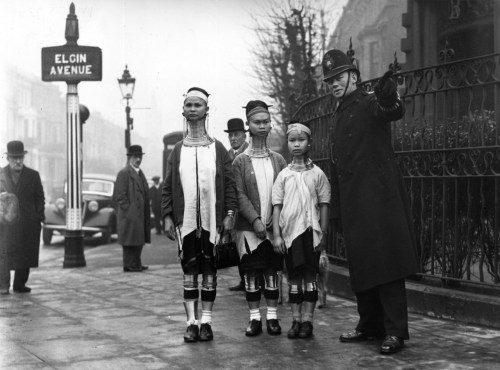 A policeman in London directing three women from Burma along Elgin Avenue, London, 1935.
