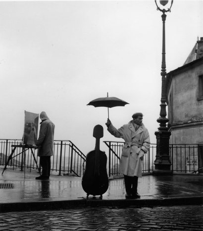 two-color:  Musician in the Rain, Maurice Baquet, Paris, 1957 by Robert Doisneau
