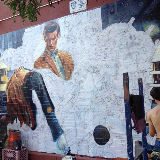 humansvsrobots: They're painting this on a wall in Brooklyn. (Taken with Instagram)