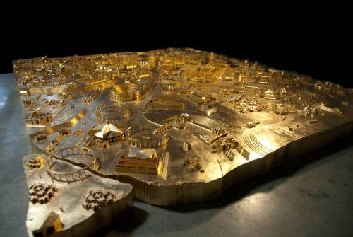 archaeology:  A model of ancient Rome created using 1) Piranesi etchings 2) a 3-D printer 3) gold leaf. Made by Yale School of Architecture students and Professor Peter Eisenman for the Venice Biennale.