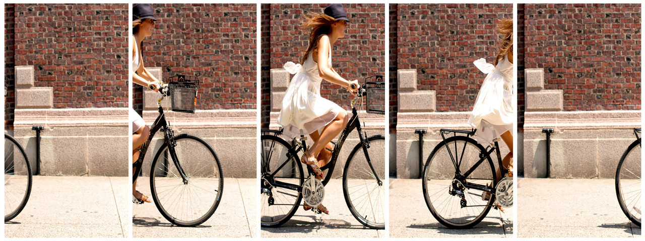 murphy cycles the city in a whimsical flowing dress.  tres chic