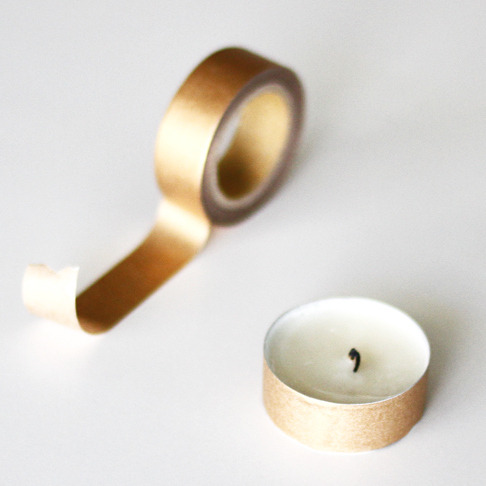 truebluemeandyou:  DIY Washi Tape Tea Light from A Merry Mishap here. Tea lights are so cheap - about $.05 to $.10 a piece and you can find them in bags anywhere. Here are some to compare at Amazon (no affiliate link). Last year I posted a really pretty DIY Glitter Tea Light that would make a cheap, nice hostess gift here. First seen at Make here.