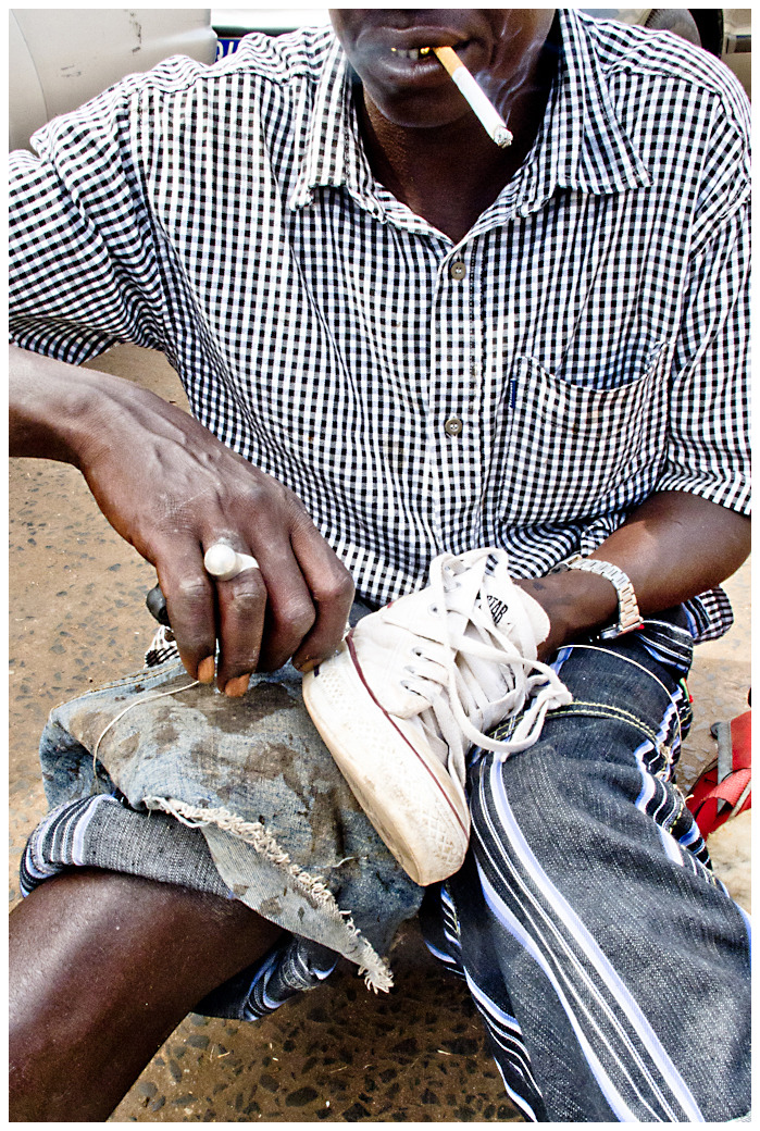 Shoe Fixer - Ferry Crossing, Gambia