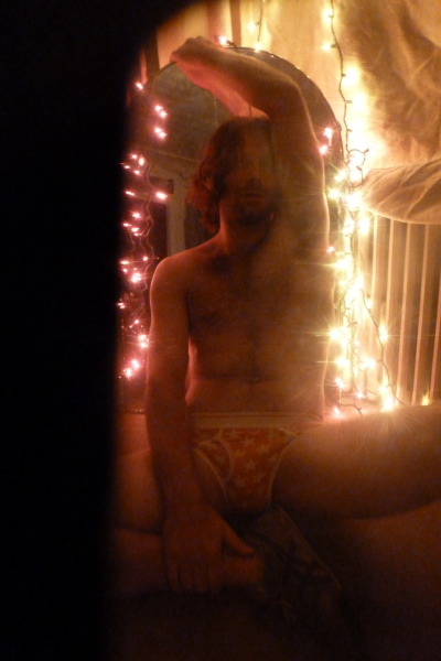 Xmas lights in my hair, stars on my underwear:  Brett Gleason photographed by Walt Cessna NYC 12
