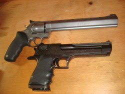 "Hand Cannons… Well the Desert Eagle .357 is kind of small in comparison to the much larger cartridges out there now. As requested, a picture of my Taurus Raging Bull 500 with the 10"" ported barrel, alongside my Desert Eagle XIX .357. I was going to add a caliber comparison but I'm out of 500 S&W ammo. It costs me about $75 for a box of 20, and since I'm job hunting I can't go buying ammo to feed it again yet."
