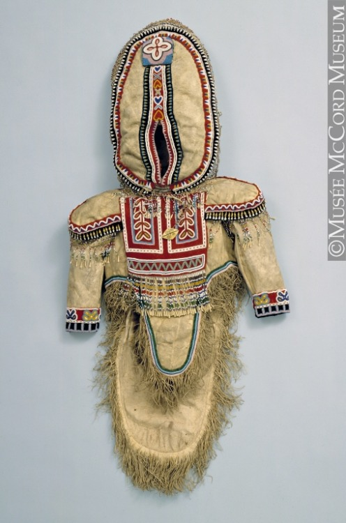 "non-westernhistoricalfashion:  Amauti Anonyme - Anonymous Central Arctic Inuit: Iglulingmiut (Aivilingmiut) 1925-1935, 20th century Caribou fur, glass beads, ivory, bone, teeth, wool braid, cotton tape and thread, stroud, sinew 48 x 128 cm Additional notes from Wikipedia: ""It is the parka worn by Inuit women of the eastern Canadian arctic. Up until about two years of age, the child nestles against the mother's back in the amaut, the built-in baby pouch just below the hood. The pouch is large and comfortable for the baby. The mother can bring the child from back to front for breast-feeding or for eliminatory functions without exposure to the elements. This traditional eastern Arctic Inuit parka designed to keep the child warm and safe from frostbite, wind and cold, also helps to develop bonding between mother and child.""  ""Traditionally the mother or female care-giver wears an amauti, but the garment may also be worn by fathers or male care-givers. A male who wears an amauti is said, in the south Baffin tradition, to be probably more successful when next hunting for certain species of animals."""
