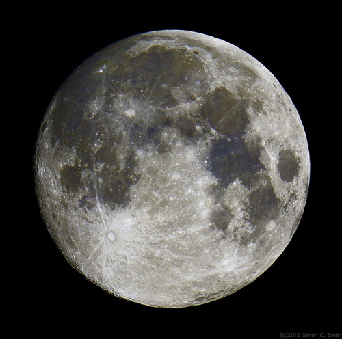 "thescienceofreality:  On a Blue Moon - APOD Image Credit & Copyright: Simon Smith ""Rising at sunset, the gorgeous Full Moon of August 31 became the second Full Moon in a month. According to modern reckoning, that makes it a Blue Moon. In fact, parts of the Full Moon do look a little blue in this sharp lunar portrait. Taken just hours before the exact full phase in delightfully clear skies over Nottingham, UK, it features eye-catching bright rays extending from the prominent young crater Tycho in the Moon's southern hemisphere. The slightly color enhanced image also brings out subtle shades of blue, a real characteristic of terrain with a high content of titanium oxide and iron. The blue lunar terrain on the right includes the dark flat expanse of the Sea of Tranquility and the Apollo 11 landing site."""