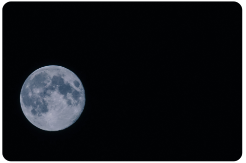 Not-So Blue Moon By the time I went outside to photograph and check on the Blue Moon, it was more white and gray than blue. [Unfortunately no volcanic smoke in the air to make it look blue ;) ] It is still glorious and perfect though. I love you space, you are always so beautiful and hopeful.  Here is a photograph I took from my backyard. I smile at the moon and it smiles back at me.