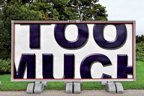 """too much"" by andrew willett exhibited at the international billboard festival ""art moves"""
