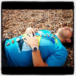 Chris getting stoned on the beach (Taken with Instagram at Brighton Beach)