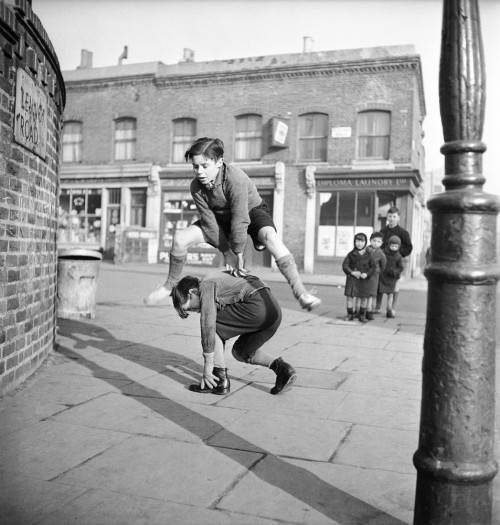 Bill Brandt A group of children playing leap frog in the street, 1950