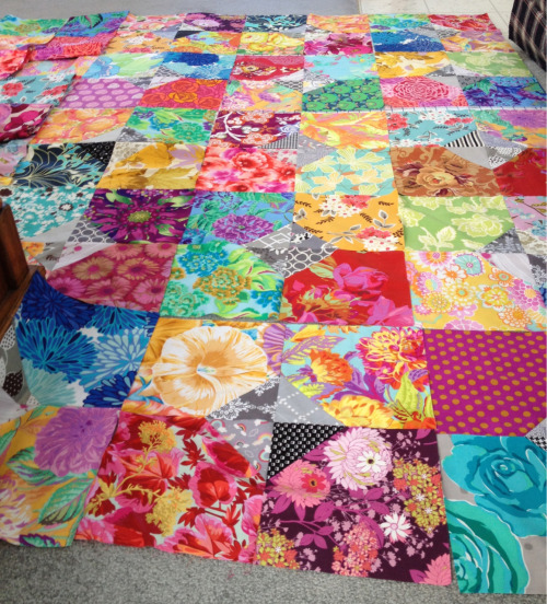 carolinaanne:  My quilt is growing (and running out of room) on the floor at the beach house!!