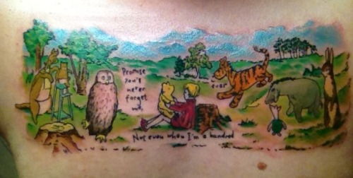 fyeahtattoos:  This is my third tattoo, a Winnie the Pooh chest piece. It was done by Urban at AAA Tattoo in Lafayette, LA. I wanted the original art work and with the same coloring style that was shown in the book. Urban did an awesome job with everything and gave me such an amazing piece of art.  I got it because I've always loved Winnie the Pooh since I was a kid and it reminds me of those good memories that I don't want to lose. I also got it with three of my closest friend's first initial, A L M, on the stump next to Christopher Robin. I always want to keep them close to my heart wherever I go in life.