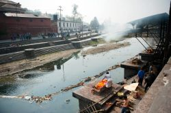 Cremation on the banks of the Bagmati River. Kathmandu, Nepal.