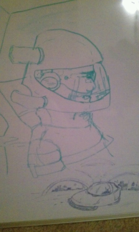 Sketching space men on whiteboard