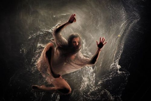 "A dancer from the Argentinian group Fuerzabruta, performs in an act entitled ""Mylar"" in a translucent pool suspended overhead on Saturday Sept. 1, 2012 in Singapore during the Night Festival which showcases international arts performances in the city-state. Photo: Wong Maye-E, Associated Press / SF.  Via San Francisco Chronicle."