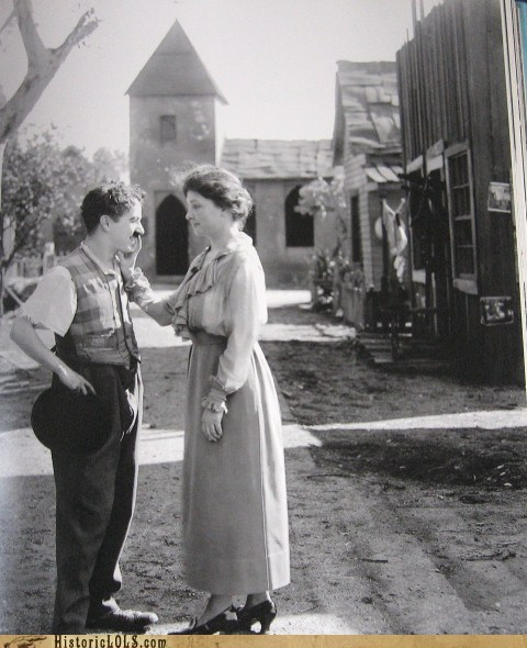 "Charlie Chaplin and Helen Keller From HistoricLOLs.com:   Charlie Chaplin historian JeTamme Derouet provides some interesting background info for this photo and describes the pair meeting in Hollywood during one of Miss Keller's speaking tours: ""They spent most of the day off alone together and they smiled and laughed a lot like they had their own private world, just walking the studio lot and talking privately together. (The picture seen here) is of her holding her hand to his mouth to feel what he is saying as he speaks to her."" To paraphrase Derouet on Chaplin's interest in sign language: ""Chaplin had worked with several deaf people throughout his career in an effort to improve his own pantomime communication skills and traveled with deaf artist Granville Redmond, who taught Charlie sign language and fingerspelling. He was also a great supporter of the deaf during a time when most people in America were trying to abolish sign language all together."" Ridiculously good guy Chaplin was a ridiculously good guy.   I loved Chaplin to begin with, but this just makes me love him more."