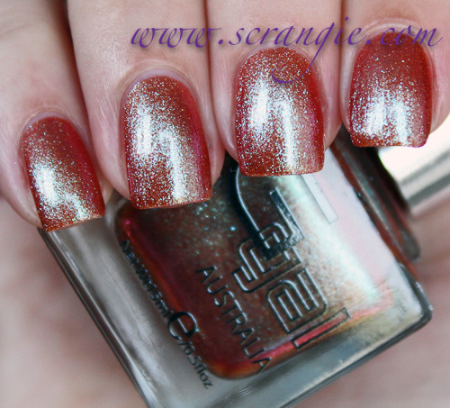 "Glitter Gal ""Last Light Brilliant"" — a reddish-brown base, accented by a glimmering blue-green duochrome glass fleck (via Scrangie: Glitter Gal Brilliant Shade Shifters Duochrome Collection Swatches and Review)"