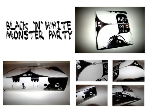 DIY Inspiration: Black and White Monster Binder from Ding-Bums here. Photo collage used with the permission of Regina of Ding-Bums. Regina also wrote me that she put laminating sheets on top of her monsters to keep the permanent marker from wearing off. I translated this site from German to English using Chrome. You could even glue on googly eyes if you wanted to.