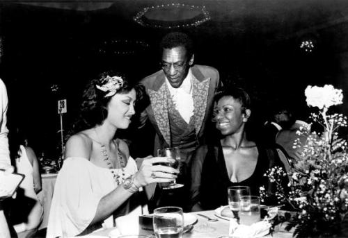 Phyllis Hyman, Bill Cosby and Natalie Cole chat at the Black Athletes Hall of Fame Awards Dinner in New York City in the mid 1970s. Photo by Michael Ochs Archives/Getty Images