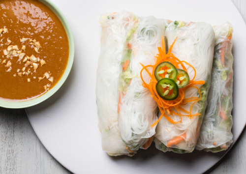 gourmet:  Spicy Summer Rolls With Peanut Sauce  We like to think of the summer roll as an elegant example of fast food: a salad packed into an edible container—in this case, paper-thin rice sheets—which results in something as beautiful to behold as it is practical to eat by hand. Better yet, the summer roll is a big win for the health-conscious because the roll is almost fat-free, and the sauce, while sporting a little peanut butter, is not highly caloric. One dipped bite yields an explosion of flavors and textures that's guaranteed to excite any palate. This recipe is part of our Gourmet Modern Menu: Fiery Fare. Click here to view the full menu.  full recipe here