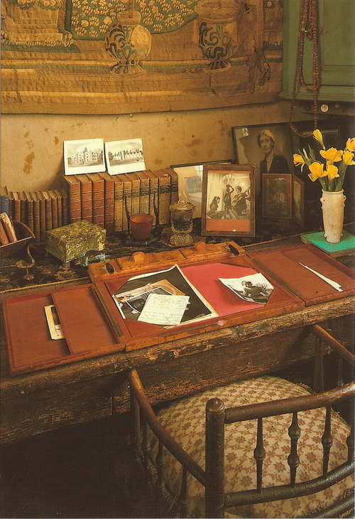 The writing room of Vita Sackville-West in the the tower at Sissinghurst Castle. There is a framed photograph of Virginia Woolf on the desk. Vita had been keeping it since 1926.