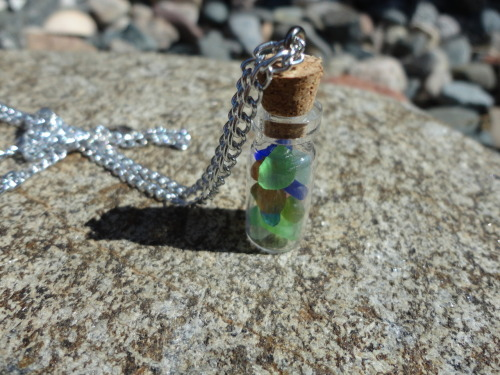 Bottle of sea glass on chain