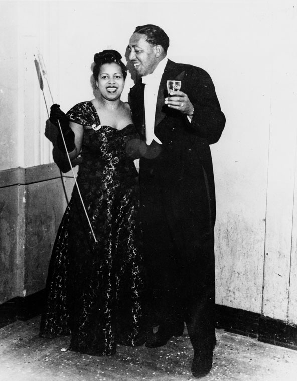 "Musical arranger Jimmy Mundy poses with his wife, Dorothy, after a performance. ca 1947. Jimmy Mundy was originally a saxophonist, but became well known as a arranger and composer for Count Basie, Earl ""Fatha"" Hines and Bennie Goodman."