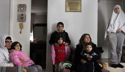 israelfacts:  Israelis move into Palestinian family's home after court backs ownership claim After a judicial battle lasting 20 years, settlers moved into a room and courtyard in East Jerusalem; the rest of the house is still under the Palestinian family's ownership. Israeli settlers moved into a room and courtyard in a Palestinian's family's home in the Ras al-Amud neighborhood of East Jerusalem on Monday morning, following rulings by courts and the bailiff's office that determined that the settlers own the 15 square meter room. The Palestinian family holds that the move is part of a scheme to make their lives miserable until they are forced abandon the house altogether. Until this morning, a Palestinian couple and their child lived in the room. The Hamdallah family lives at the edge of Ma'aleh Hazeitim, the largest settlement in Palestinian East Jerusalem, which is home to more than a hundred Jewish families. [These settlements are illegal under international law as they are built on stolen Palestinian land.] The settlement was constructed on land purchased in 1990 by settler patron Irwin Moskowitz from Chabad and Vohlin Chassidic groups, who claimed the land after proving they purchased it before 1948. The Hamdallah family has lived in the building since 1952. Moskowitz's representatives have waged a judicial battle to evacuate the Hamdallah family from the house since 1992, in order to enable the expansion of Ma'aleh Hazeitim. Shlomo Lecker, the family's attorney, managed to prove a statute of limitations concerning most of the house, but in 2005, the Jerusalem District Court ruled that the family must evacuate parts of the house constructed after 1989. After several more judicial turnabouts, the Bailiff's Office determined that the settlers are entitled to seize the room and the courtyard. According to witnesses, the settlers plan to fence off the room and courtyard, separating it from the rest of the house. A substantial police force secured the entrance to the room, but the event passed without any notable incidents. Haaretz Photo: The Hamdallah family in 2009. Credit: Michal Fattal  Absurd.