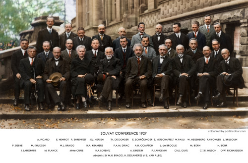 Colorized photo of physicists who attended the 1927 Solvay Conference, including Einstein, Curie, Bohr, Compton, Heisenberg, Schrödinger, etc.
