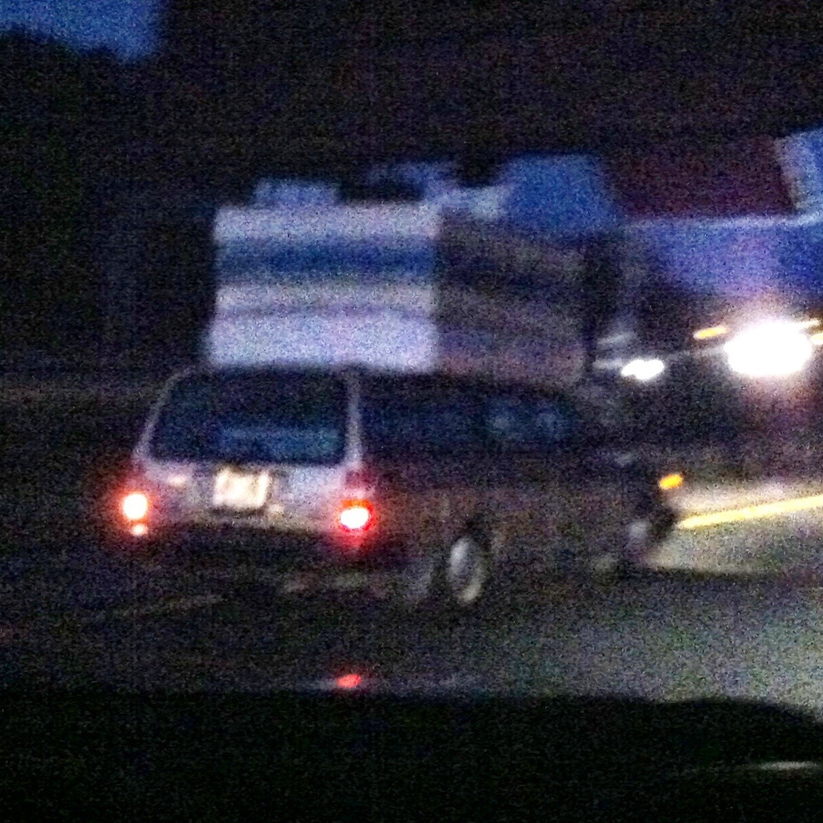 That's definitely the first time I've ever seen someone transporting four mattresses on top of a car. I sure hope he had a good hold on them out the driver side window.